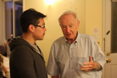 Herbert Heller talks with a student